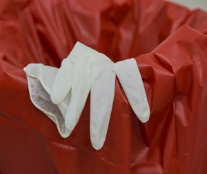 Infectious waste in red bags include disposed gloves